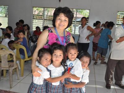 Kim Demars with Students in Taloc School