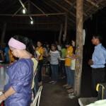 Pr. Alpas Leading Out in Prayer Before Dinner